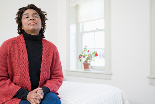 woman Practicing EMDR therapy at home
