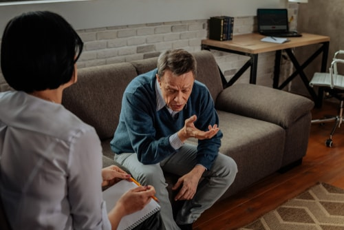 Experienced psychotherapist talking to patient