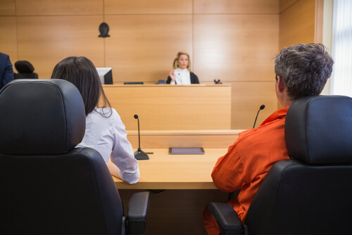 Lawyer and client listening to judge