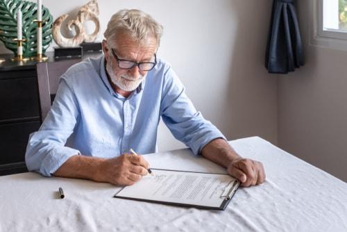 Senior man checks his insurance