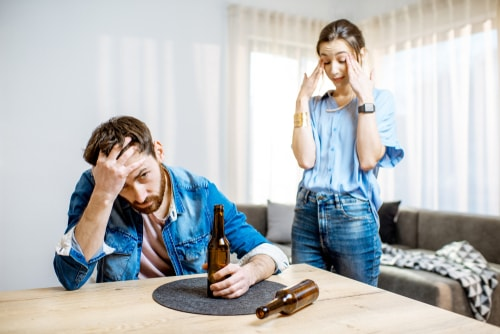 man suffering from alcoholism at home
