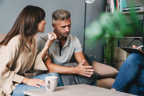 nervous couple having conversation about addiction consequences