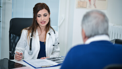 senior patient speaking to a female doctor