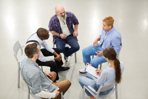 people sitting in circle during therapy session