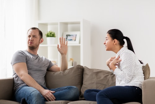 wife speaking with addicted husband