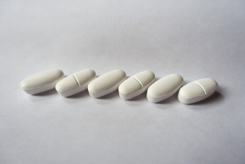 white oblong pills