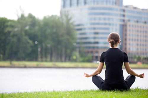 recovered woman relaxing meditating
