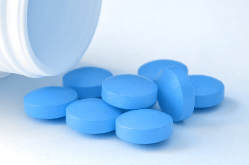 bblue viagra pills on a table