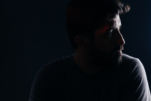 depressed man in dark room