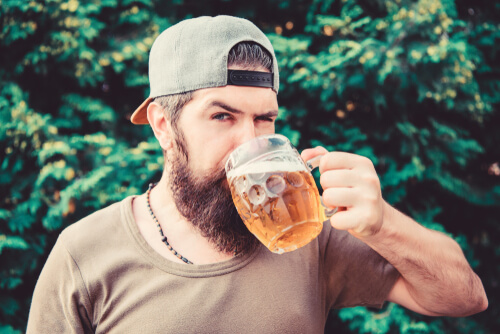 bearded man drinking beer