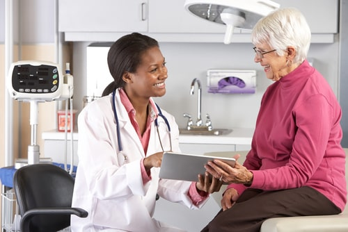 Doctor Discussing Records with patient