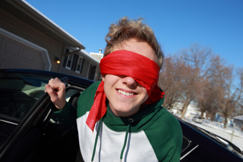 teen driving in a blindfold
