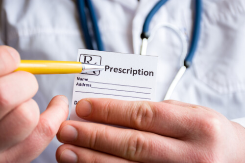 doctor holding a medical prescription