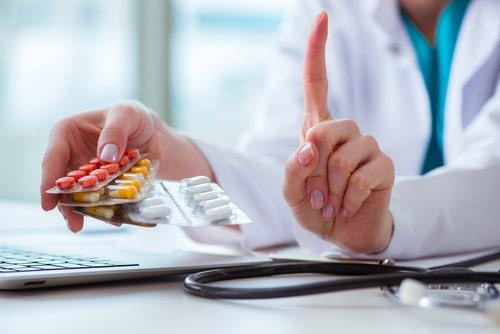 Doctor with prescribed Seroquel tablets.
