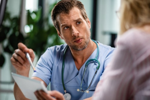 Male doctor communicating with female patient.