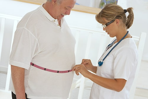 Woman doctor examining an obese patient.