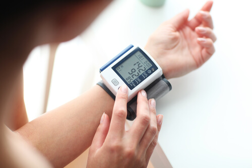 woman measuring blood pressure