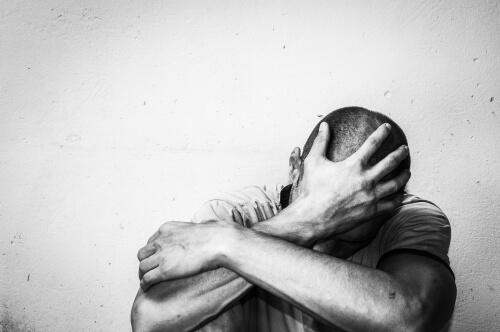 Depressed Man Near Wall