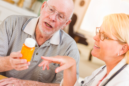 elderly patient talking to a nurse about medication