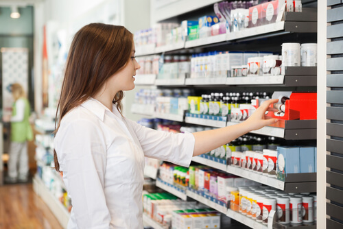 Woman Looking At Medicine Shelf