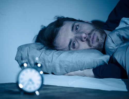 Man With Insomnia And Clock