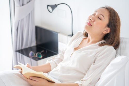 Woman Fell Asleep While Reading A Book