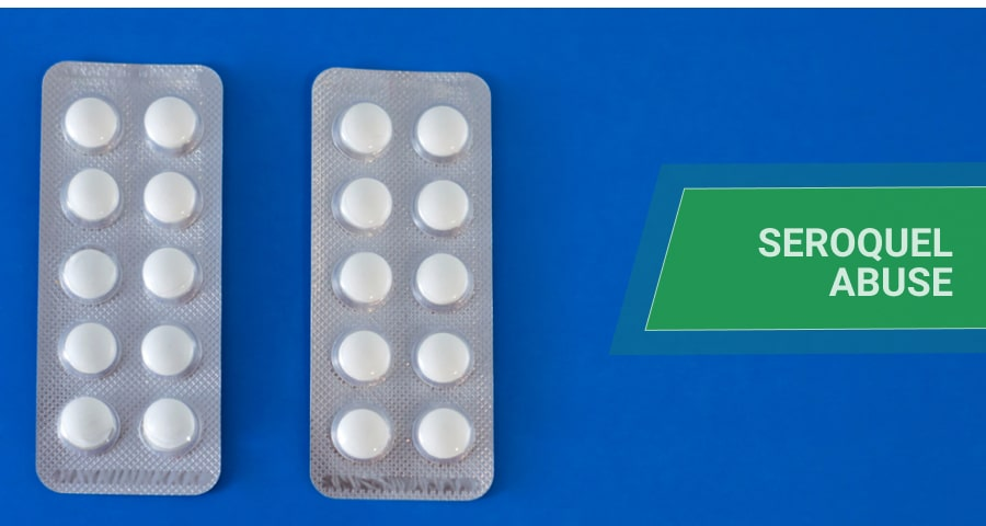 two blisters of pills on blue background