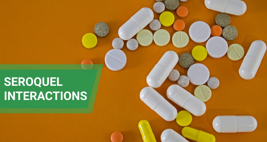 Various pills and capsules on orange background.