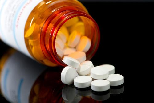 bottle with white round pills