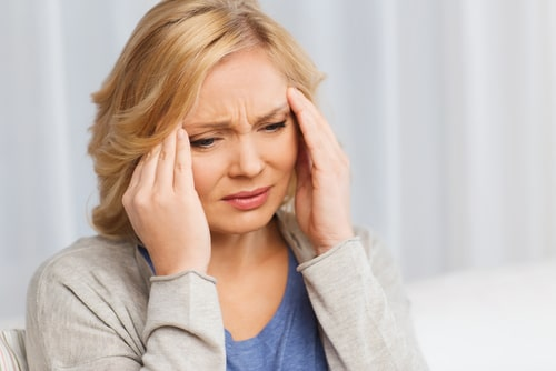 woman suffering from migraines.