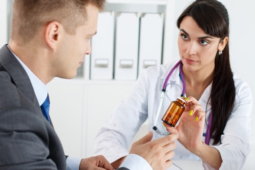 doctor giving lisinopril to male patient