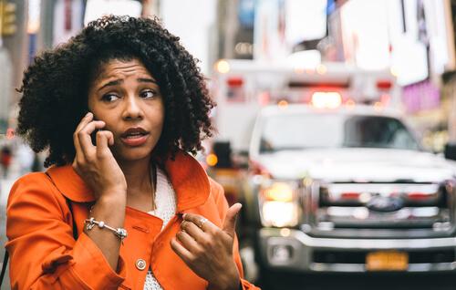 woman calling an emergency