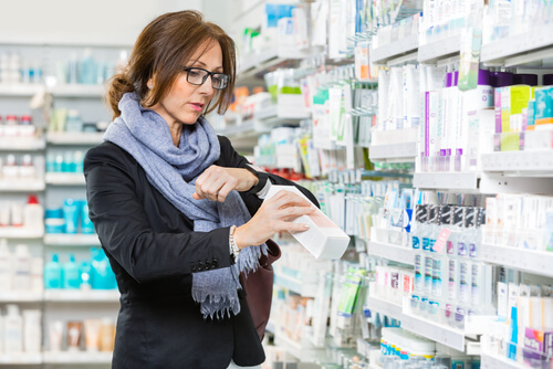 Woman Buys Medicine In Drug Store