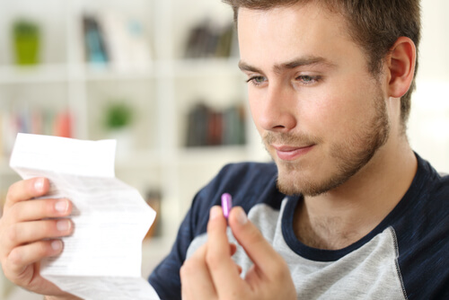 Man Reading Medical Leaflet
