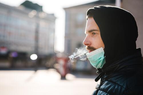 man smokes