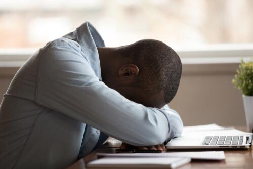 Black Male Sleeping On A Table