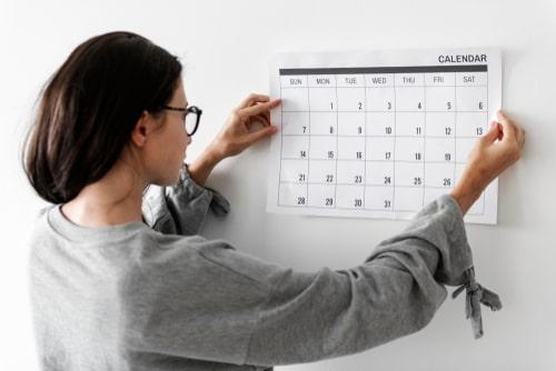Woman checking her calendar.