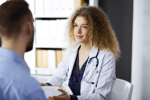 Female doctor and male patient discussing adderall withdrawal plan.