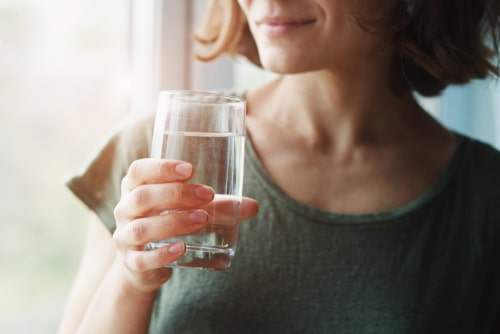 Woman Drinks fresh water.
