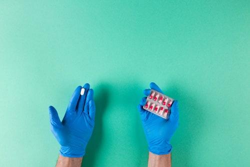 Doctor holding medicine pills.