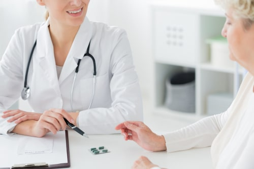 Doctor prescribes supplements to a senior patient.