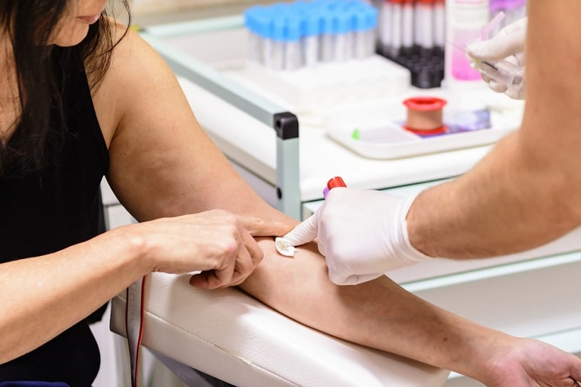 Doctor carries out a blood test.