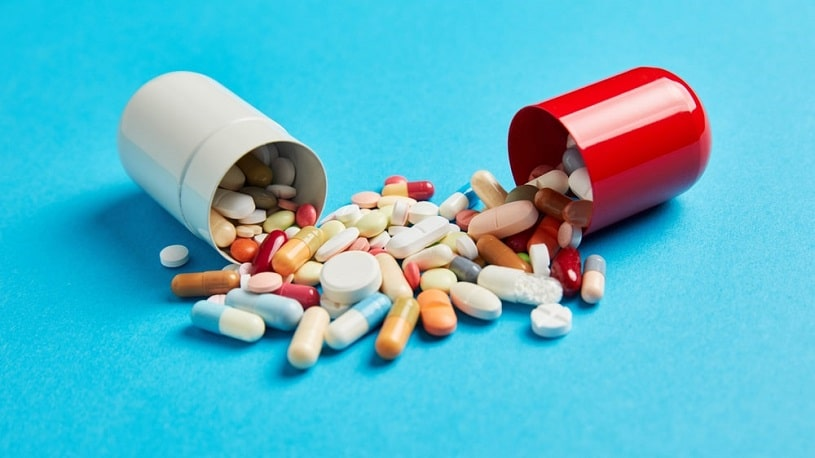 Colorful medicines drugs in large capsule