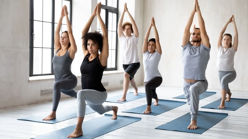 People doing exercises and yoga.