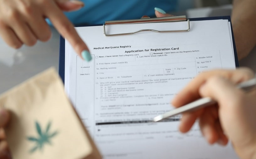 Woman pointing at medical marijuana card.