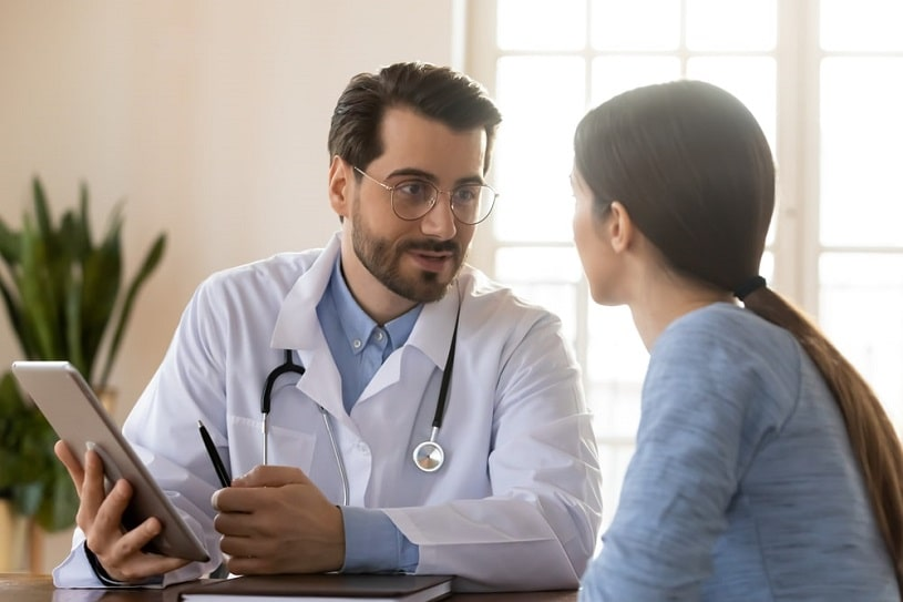 Doctor consults a patient about drug use.