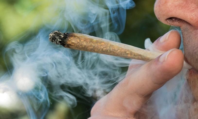 Man smoking marijuana on the street.