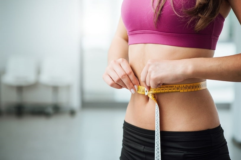 Woman worried about weight gain.