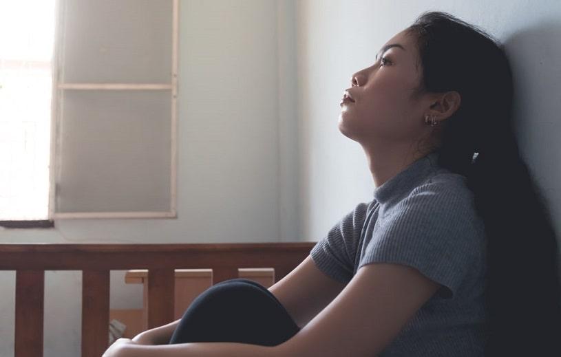 Asian woman at home.