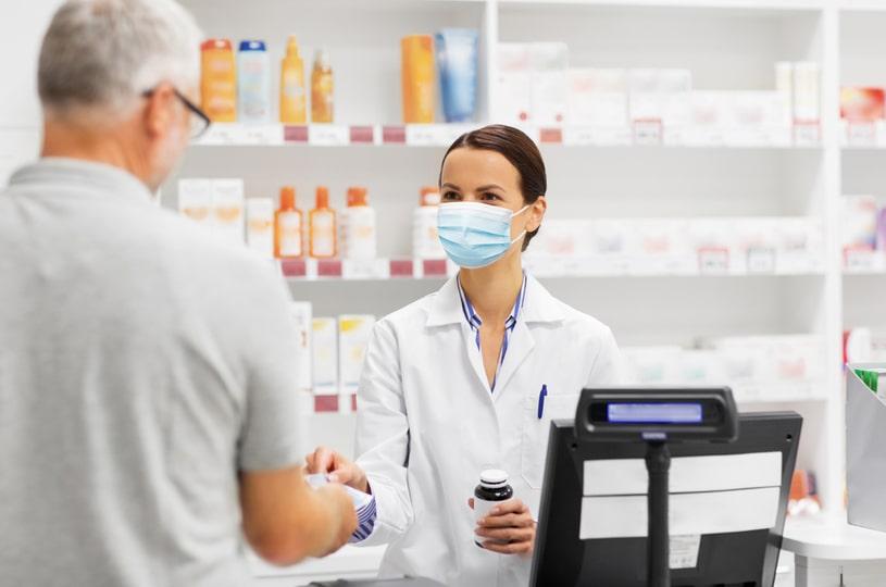 An elderly man buys gabapentin from a pharmacy.